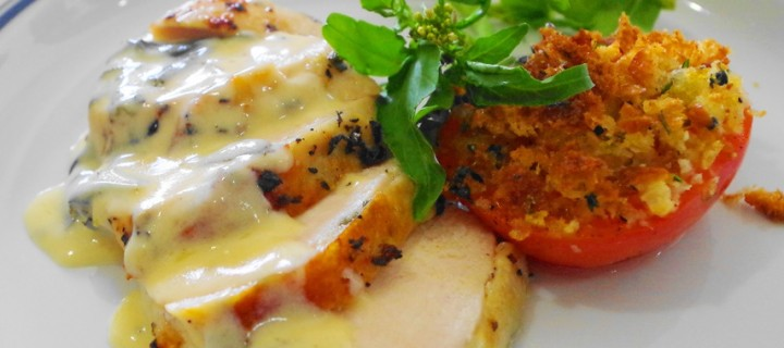 roast chicken sage-sour cream sauce with herb baked tomato